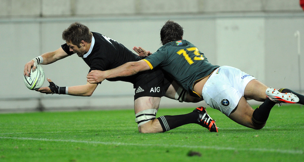 New Zealand's Richie McCaw dives into score in the tackle of South Africa's Jan Serfontein in the Investec International rugby at Westpac Stadium, Wellington, New Zealand, Saturday, September 13, 2014. Credit:SNPA / Ross Setford