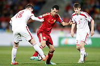 Spain's Sergio Busquets (c) and Belarus' Sergei Politevich (l) and Stanislav Dragun during 15th UEFA European Championship Qualifying Round match. November 15,2014.(ALTERPHOTOS/Acero)