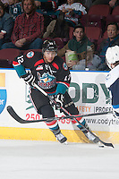 KELOWNA, CANADA - DECEMBER 3: Tyrell Goulbourne #12 of Kelowna Rockets skates with the puck against the Saskatoon Blades on December 3, 2014 at Prospera Place in Kelowna, British Columbia, Canada.  (Photo by Marissa Baecker/Shoot the Breeze)  *** Local Caption *** Tyrell Goulbourne;