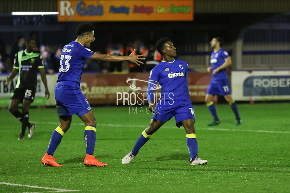 AFC Wimbledon striker Dominic Poleon (10) scores a goal 3-0 and celebrates with AFC Wimbledon striker Lyle Taylor (33) during the The Emirates FA Cup 1st Round Replay match between AFC Wimbledon and Bury at the Cherry Red Records Stadium, Kingston, England on 15 November 2016. Photo by Stuart Butcher.