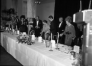 President Reagan Visits Ireland..(formal dinner)..1984.04.06.1984.06.04.1984.4th June 1984..The Banquet for President and Mrs Reagan was held in Dublin Castle,Dame St,Dublin..Photo of the top table as President Reagan assists Mrs Joan Fitzgerald to her seat.