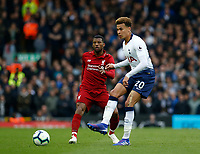 Football - 2018 / 2019 Premier League - Liverpool vs. Tottenham Hotspur<br /> <br /> Dele Alli of Tottenham Hotspur passes through midfield as Georginio Wijnaldum of Liverpool looks on, at Anfield.<br /> <br /> COLORSPORT/ALAN MARTIN