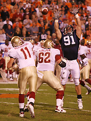 UVA's Chris Long (91) reaches for a Drew Weatherford (11) pass in action on October 15, 2005.  The Cavaliers upset #4 Florida State 26-21 at Scott Stadium in Charlottesville, VA.<br />