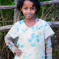 A young girl poses for a portrait in Motta, Ethiopia