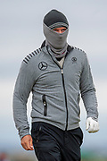 Marcel Siem wrapped up against the elements during the final round of the Alfred Dunhill Links Championships 2018 at West Sands, St Andrews, Scotland on 7 October 2018