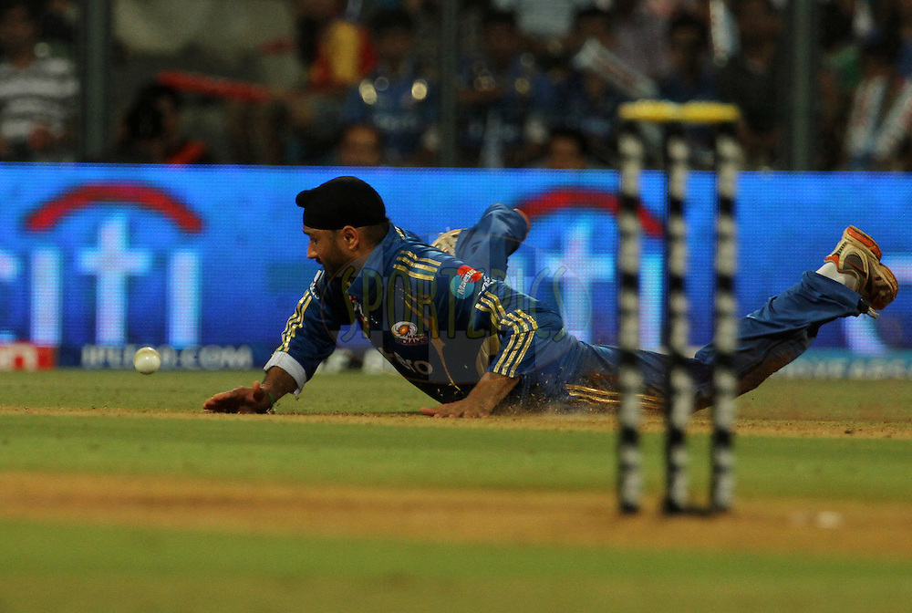 Mumbai Indian captain Harbhajan Singh dives as he fields during match 54 of the Indian Premier League ( IPL) 2012  between The Mumbai Indians and the Royal Challengers Banglore held at the Wankhede Stadium in Mumbai on the 9th May 2012..Photo by Vipin Pawar/IPL/SPORTZPICS.