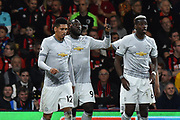 Goal - Romelu Lukaku (9) of Manchester United celebrates scoring a goal to give a 0-2 lead to the away team with Chris Smalling (12) of Manchester United and Paul Pogba (6) of Manchester United during the Premier League match between Bournemouth and Manchester United at the Vitality Stadium, Bournemouth, England on 18 April 2018. Picture by Graham Hunt.