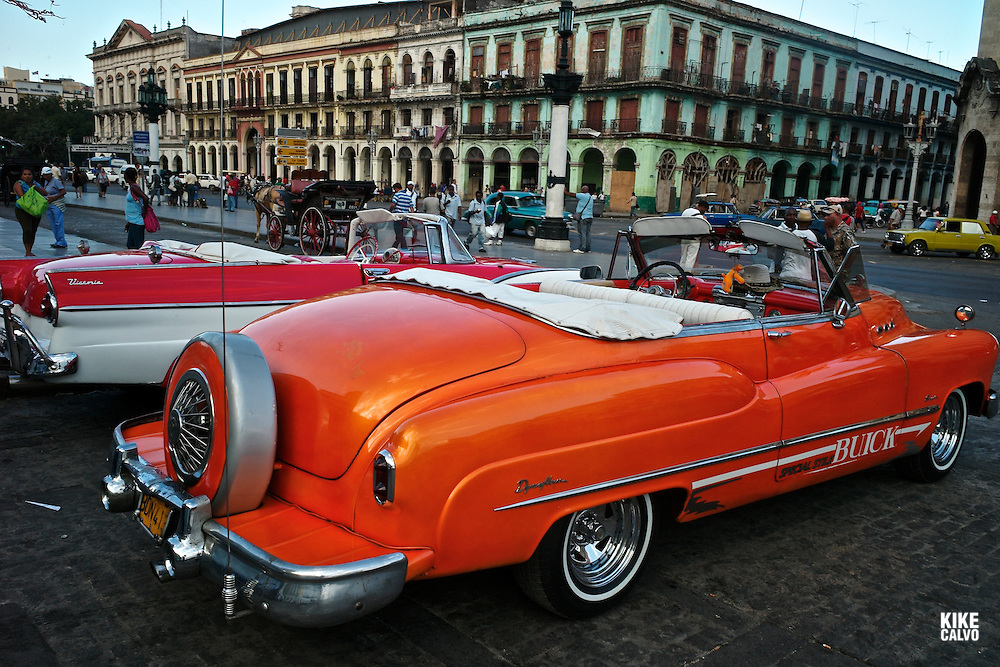 Colorful old American cars , now used as taxis, parked at Plaza de la Fraternidad at Parque Central in Old Havana