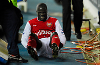 Photo: Leigh Quinnell/Sportsbeat Images.<br /> Reading v Arsenal. The FA Barclays Premiership. 12/11/2007. Arsenals Emmanuel Eboue takes a tumble through the advertising boards at the edge of the pitch.