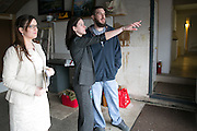 Cory Wojewodka, center, and Brandon Mastrodonato, right, tour a home in Henrietta with Charlene Lally of Nothnagle Realtors on Thursday, March 17, 2016. The home is on Lehigh Station Road, directly across from Rush-Henrietta High School.