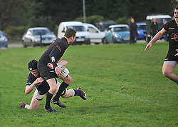 Westport's Tomas Dever tackles Connemara's Peter O'Toole during the junior league match between Connemara and Westport in Clifden.<br /> Pic Conor McKeown