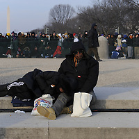 John (R) and Viester (L) Wells of Highland,California  take a break at the reflecting pool of the U.S. Capital for the swearing in of Barack Obama as the 44th President of the United States of America during his Inauguration Ceremony on Capitol Hill in Washington on January 20, 2009.   (Mark Goldman/ Goldmine Photos)