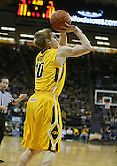 January 19 2013: Iowa Hawkeyes guard Mike Gesell (10) puts up a shot during the first half of the NCAA basketball game between the Wisconsin Badgers and the Iowa Hawkeyes at Carver-Hawkeye Arena in Iowa City, Iowa on Sautrday January 19 2013. Iowa defeated Wisconsin 70-66.