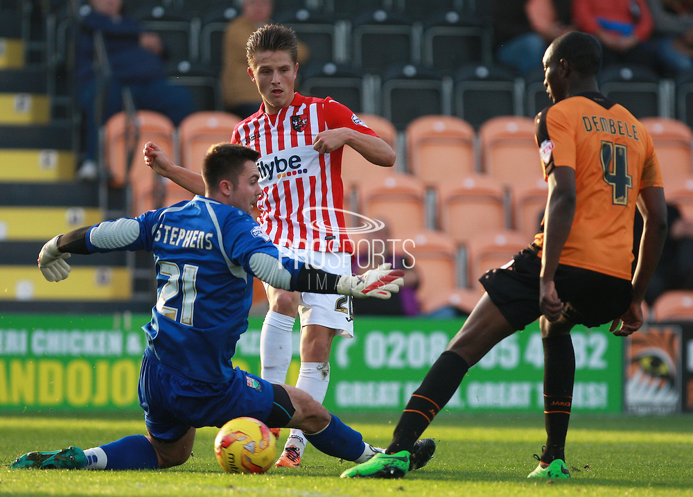Exeter City striker Tom Nichols is thwarted by Barnet goalkeeper Jamie Stephens during the Sky Bet League 2 match between Barnet and Exeter City at The Hive Stadium, London, England on 31 October 2015. Photo by Bennett Dean.