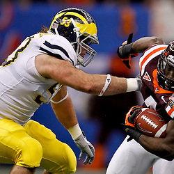 January 3, 2012; New Orleans, LA, USA; Virginia Tech Hokies running back David Wilson (4) runs past \Michigan Wolverines defensive end Ryan Van Bergen (53) during the first quarter of the Sugar Bowl at the Mercedes-Benz Superdome.  Mandatory Credit: Derick E. Hingle-US PRESSWIRE