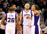 Nov. 23, 2012; Phoenix, AZ, USA; Phoenix Suns forward Michael Beasley (0) , center Marcin Gortat (4) , forward Markieff Morris and guard Shannon Brown (26) talk on the court during the game against the New Orleans Hornets in the first half at US Airways Center. Mandatory Credit: Jennifer Stewart-US PRESSWIRE