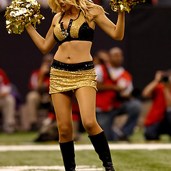 November 21, 2010; New Orleans, LA, USA; A New Orleans Saints Saintsations cheerleaders performs on the field during the second half of a game against the Seattle Seahawks at the Louisiana Superdome. The Saints defeated the Seahawks 34-19. Mandatory Credit: Derick E. Hingle