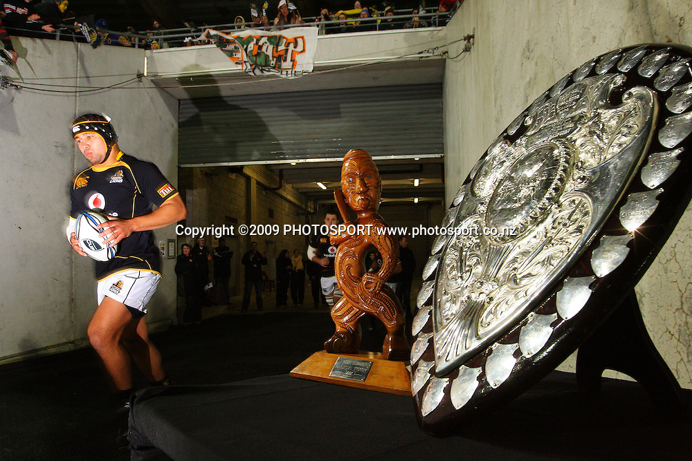 Wellington captain Jacob Ellison runs out past the Mike Gibson Memorial Trophy and the Ranfurly Shield.<br /> Air NZ Cup Ranfurly Shield match - Wellington Lions v Otago at Westpac Stadium, Wellington, New Zealand. Friday, 31 July 2009. Photo: Dave Lintott/PHOTOSPORT