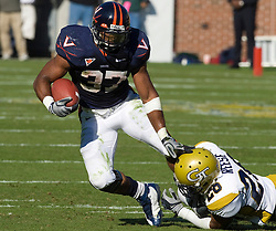 Virginia running back Cedric Peerman (37) tries to shed a tackle from Georgia Tech cornerback Dominique Reese (26).  The Virginia Cavaliers defeated the #18 ranked Georgia Tech Yellow Jackets 24-17 in NCAA Division 1 Football at Bobby Dodd Stadium on the campus of Georgia Tech in Atlanta, GA on October 25, 2008.
