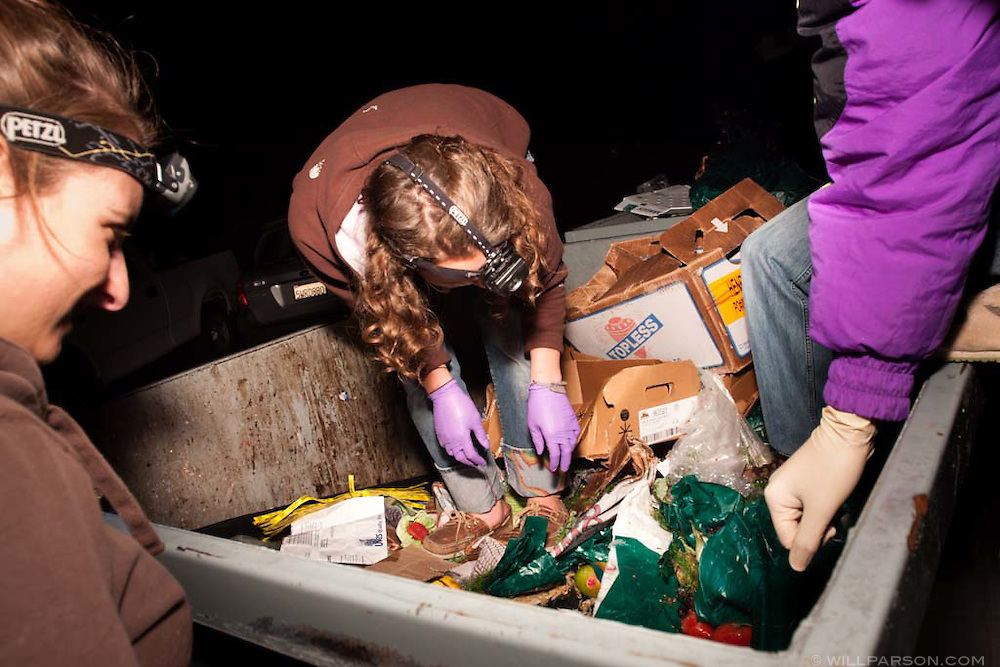 College students and freegans converge on a grocery store dumpster in San Diego, California. Freeganism is a movement based on limited participation in the conventional economy and minimal consumption of resources.