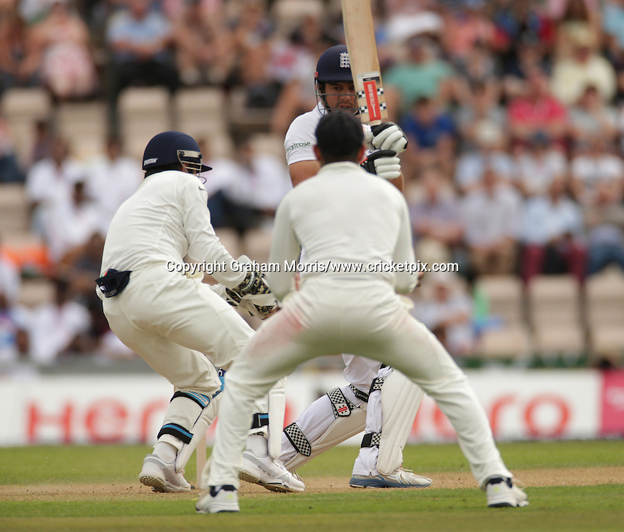 Alastair Cook is caught by wicket keeper Mahendra Singh Dhoni on 95 during the third Investec Test Match between England and India at the Ageas Bowl, Southampton. Photo: Graham Morris/www.cricketpix.com (Tel: +44 (0)20 8969 4192; Email: graham@cricketpix.com) 27/07/14