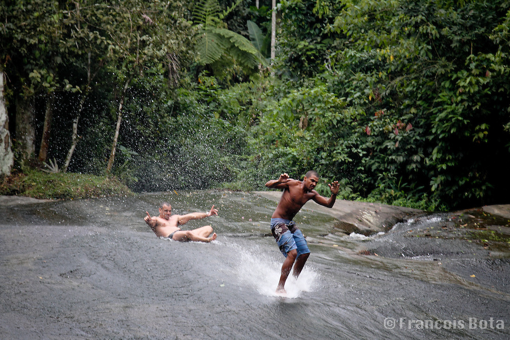 Waterfall surfing or surfar na pedra in Brazil