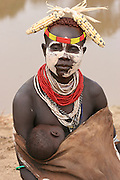 Africa, Ethiopia, Omo Valley, Karo tribesmen warrior the Omo river in the background