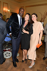 Left to right, OZWALD BOATENG, ROSEY CHAN and LARA BOHINC at the Sindika Dokolo Art Foundation Dinner held at The Cafe Royal, Regent Street, London on 18th October 2014.
