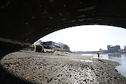 Chiswick. London. Tideway Scullers boathouse, sculler, boating for training  looking from the foreshore, passing under Chiswick Bridge. 2011 Women's Head of the River Race, Mortlake to Putney, over the  Championship Course.Taken from Chiswick Bridge.  Saturday  19/03/2011 [Mandatory Credit, Peter Spurrier/Intersport-images]