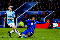 Phil Foden of Manchester City shoots at goal past Hamza Choudhury of Leicester City - Mandatory by-line: Robbie Stephenson/JMP - 18/12/2018 - FOOTBALL - King Power Stadium - Leicester, England - Leicester City v Manchester City - Carabao Cup Quarter Finals