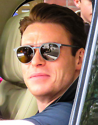 """© Licensed to London News Pictures. 28/10/2018. London, UK. British actor Richard Madden (star of Bodyguard) and Taron Egerton (Star of Kingsmen NOT PICTURED), both of whom are to feature in """"Rocketman"""" the Elton John biopic, filming for a CBS television production in a Range Rover in Westminster, London. Photo credit: Graham Long/LNP"""