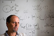 In his UC Berkeley, CA office, astronomer Geoff Marcy is discussing the effects of Einstein's theory of relativity in the measurements of the Doppler shift that allow his team to detect planets.   They make all of their observations from the Earth that moves so fast in its orbit around the Sun that they must include the theory of relativity in their calculations. Exoplanets & Planet Hunters.