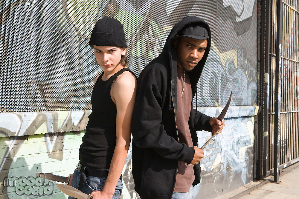 Two young men posing with knives