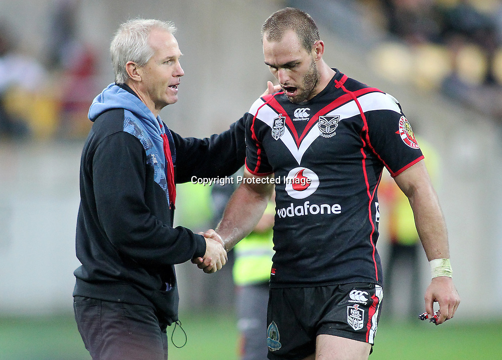 Warriors coach Matthew Elliott congratulates captain Simon Mannering on a job well done during the NRL match between The Warriors v Wests Tigers. Westpac Stadium, Wellington. 29 March 2014. Photo.: Grant Down / www.photosport.co.nz
