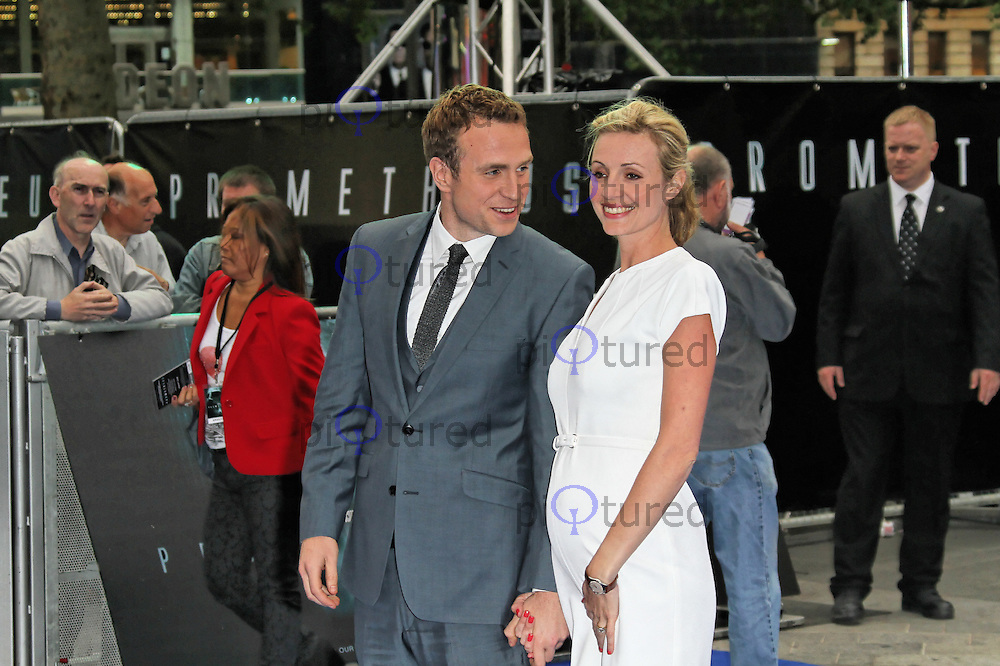 LONDON - MAY 31: Rafe Spall; Elize du Toit attend the World Film Premiere of 'Prometheus' at the Empire Cinema, Leicester Square, London, UK. May 31, 2012. (Photo by Richard Goldschmidt)