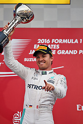 GP von Japan 2016 in Suzuka / 091016<br /> <br /> ***Formula One Grand Prix of Japan on October 9, 2016 in Suzuka.***<br /> <br /> GP von Japan 2016 in Suzuka / 091016<br /> <br /> ***Formula One Grand Prix of Japan on October 9, 2016 in Suzuka.***<br /> <br /> Race winner Nico Rosberg (GER) Mercedes AMG F1 celebrates on the podium.<br /> 09.10.2016. Formula 1 World Championship, Rd 17, Japanese Grand Prix, Suzuka, Japan, Race Day.<br /> - www.xpbimages.com, EMail: requests@xpbimages.com - copy of publication required for printed pictures. Every used picture is fee-liable. © Copyright: Moy / XPB Images