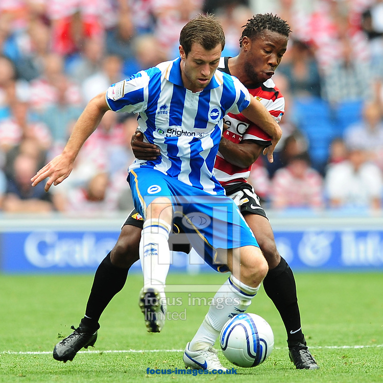 Picture by Alex Broadway/Focus Images Ltd.  07905 628187.6/8/11.Ashley Barnes of Brighton and Mustapha Dumbuya of Doncaster during the NPower Championship game at the Amex Community Stadium, Brighton, East Sussex.