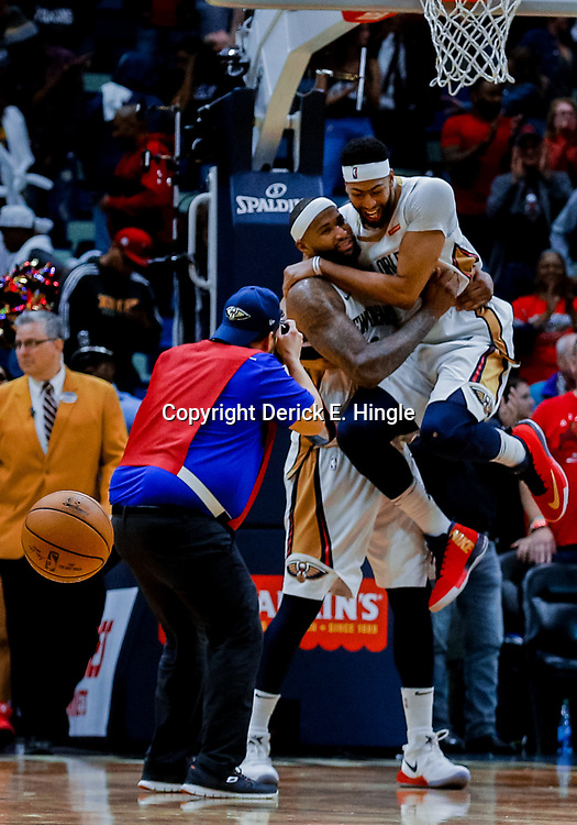 Jan 22, 2018; New Orleans, LA, USA; New Orleans Pelicans forward Anthony Davis (23) jumps into the arms of center DeMarcus Cousins (0) after a win in double overtime against the Chicago Bulls at the Smoothie King Center. The Pelicans defeated the Bulls 132-128 in double overtime. Mandatory Credit: Derick E. Hingle-USA TODAY Sports