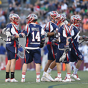 Ryan Boyle #14 of the Boston Cannons and other members of the Boston Cannons celebrate a goal during the game at Harvard Stadium on May 17, 2014 in Boston, Massachuttes. (Photo by Elan Kawesch)