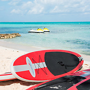 Red Kayaks and paddle boards ready for rent. Rum Point, East End. Grand Cayman Island.