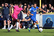 AFC Wimbledon striker Andy Barcham (17) taking on Southend United striker Nile Ranger (50) during the EFL Sky Bet League 1 match between AFC Wimbledon and Southend United at the Cherry Red Records Stadium, Kingston, England on 25 March 2017. Photo by Matthew Redman.