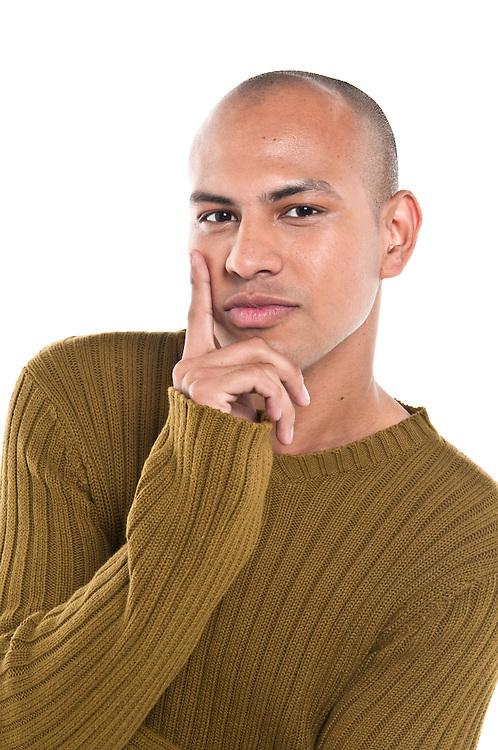 Young man looking at camera thinking, isolated.