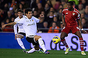 VALENCIA, SPAIN - JANUARY 12: (L) Daniel Parejo of Valencia CF competes for the ball with (R) Geoffrey Kondogbia of Sevilla FC during the Liga BBVA between Valencia CF and Sevilla FC at the Mestalla Stadium on January 12, 2013 in Valencia, Spain. (Photo by Aitor Alcalde Colomer).