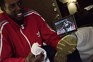 With YouTube clips of legendary umpire ejections playing on his laptop, Gerald Perry, 25, of Atlanta, Ga. cleans and shines his shoes as he readies his uniform for the next day of Umpire School.