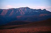 Giant's Castle 3314m, with the South Ridge sweeping down to the The Gable (right).  Winter sunrise view from Ka-Mpumulwana Ridge, Lotheni. Ukhahlamba-Drakensberg Park, KwaZulu-Natal, South Africa.  Nikon F90, 28-70/3.5-4.5D. Fuji RDPII. September 1996.