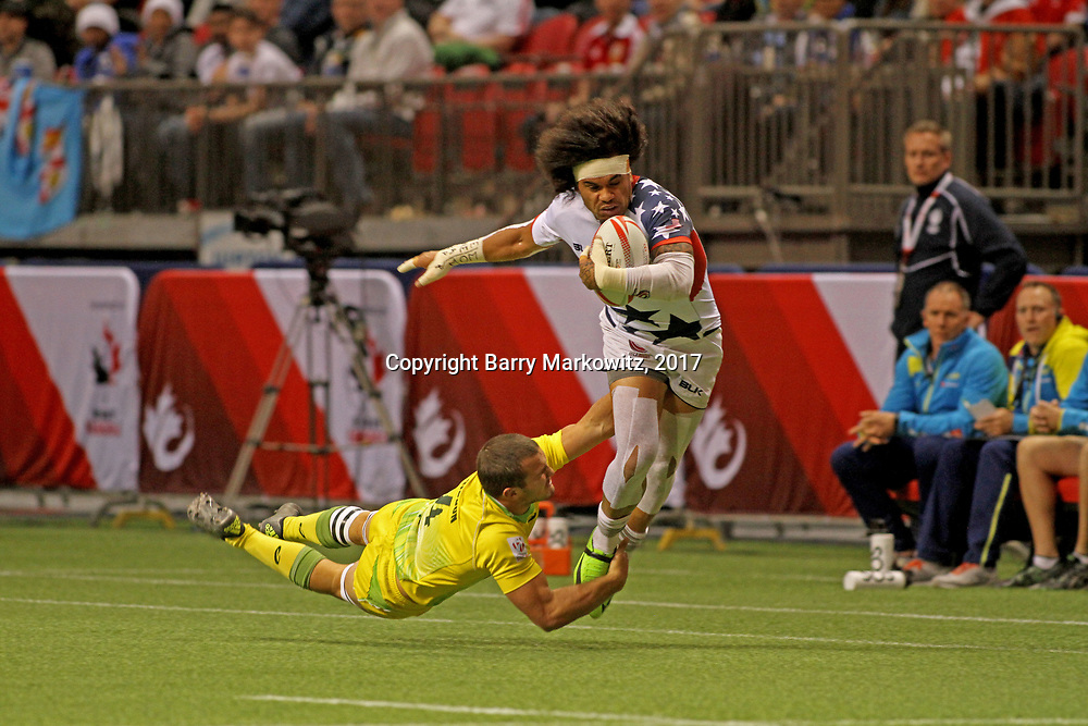 Folau Niua make a powerful drive to set up teamate Maka Unufe's 2nd half try in the USA Eagles 29-5 victory over Australia in Day 1 of the Canada 7's, BC Place Stadium, Vancouver, Canada.