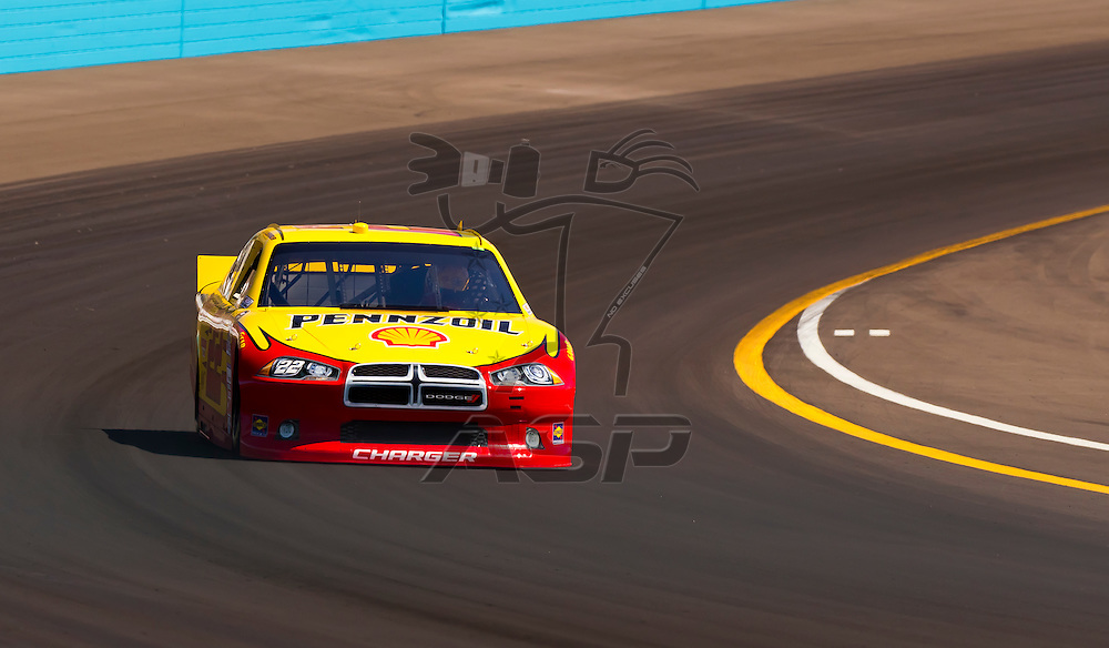 AVONDALE, AZ - MAR 03, 2012:  A.J. Almendinger (22) brings his NASCAR Sprint Cup car through turn 4 during qualifying for the Subway Fresh Fit 500 race at the Phoenix International Raceway in Avondale, AZ.