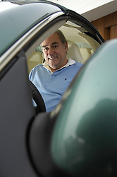 ZURICH,  SWITZERLAND - DEC-15-2006 - Hans-Peter Fassler inside his Aston Martin DB9 at his water-front home near Zurich. (PHOTO © JOCK FISTICK)