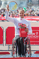 Marcel Hug of Switzerland, winner of the Men's wheelchair race on the podium at the Virgin Money London Marathon 2014 at the finish line on Sunday 13 April 2014<br /> Photo: Dillon Bryden/Virgin Money London Marathon<br /> media@london-marathon.co.uk