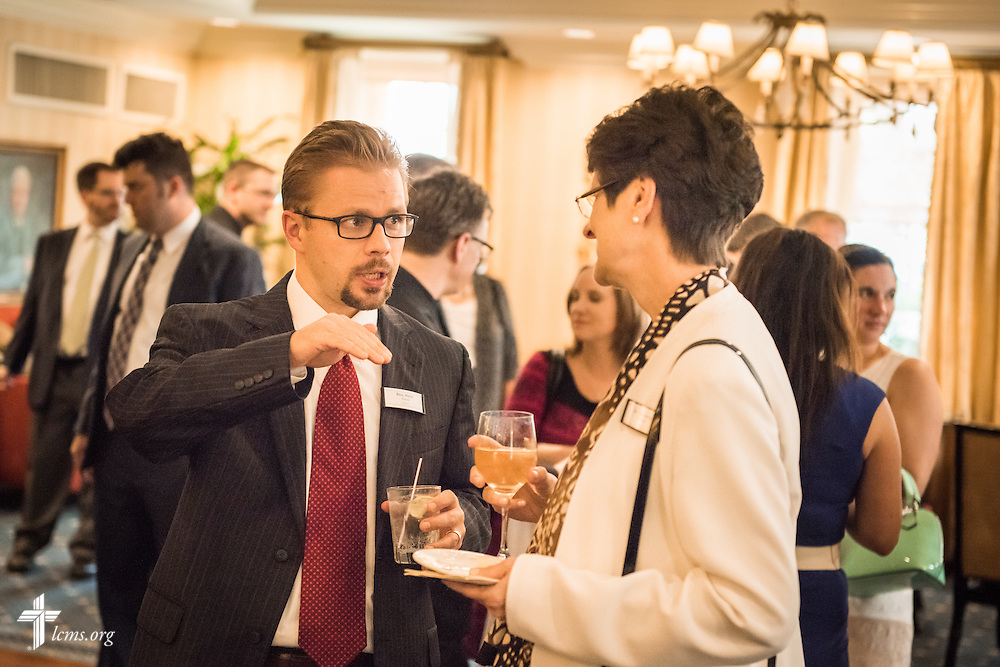 The Rev. Hans Fiene, pastor of River of Life Lutheran Church in Channahon, Ill., talks to Dr. Beverly K. Yahnke, executive director for Christian counsel at DOXOLOGY, during a Let's Talk Life, Marriage and Religious Liberty event on Tuesday, September 8, 2015, a the Capitol Hill Club in Washington, D.C. LCMS Communications/Erik M. Lunsford